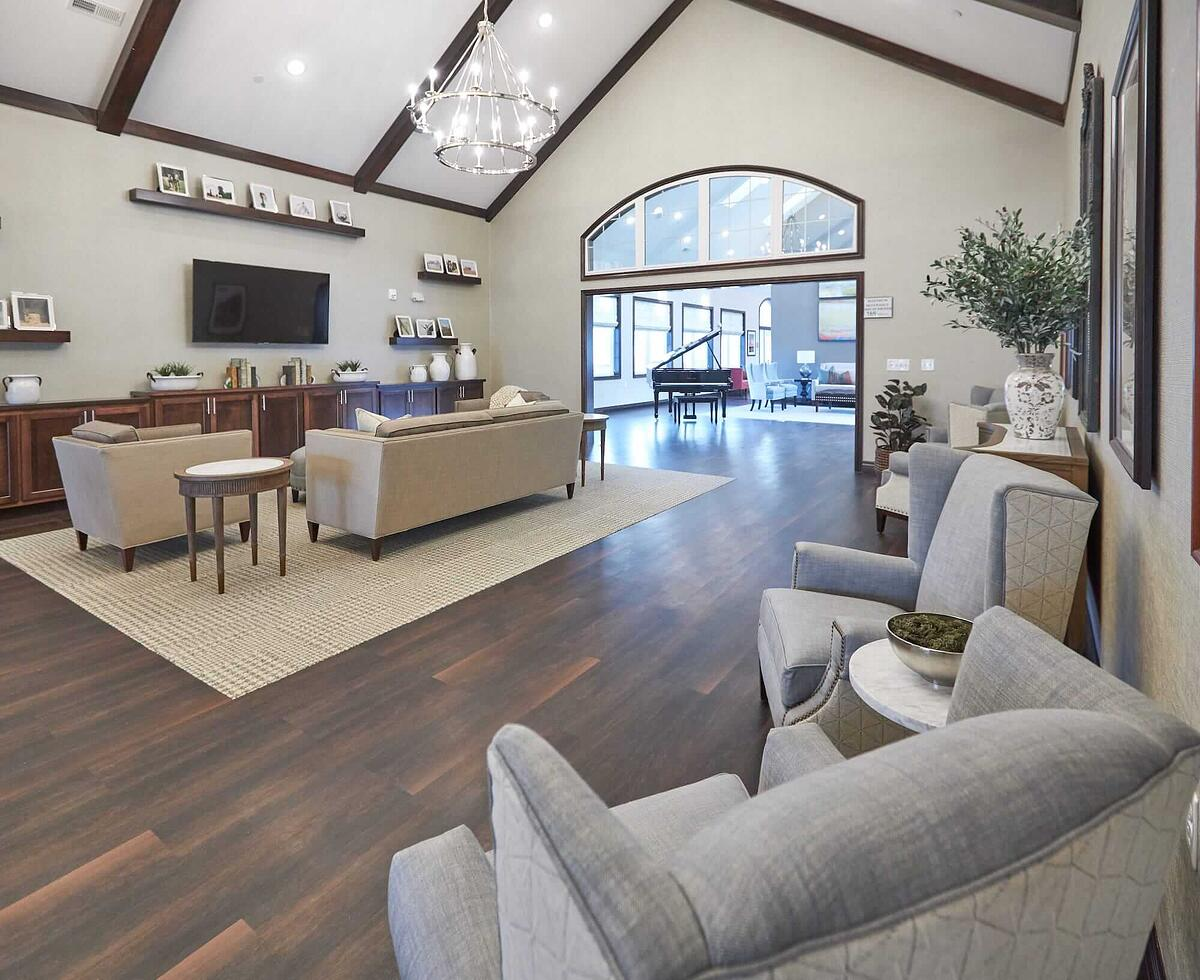 We Embrace Our Midwestern Values - open lobby space with hardwood flooring, floating shelves, and built-in cabinetry