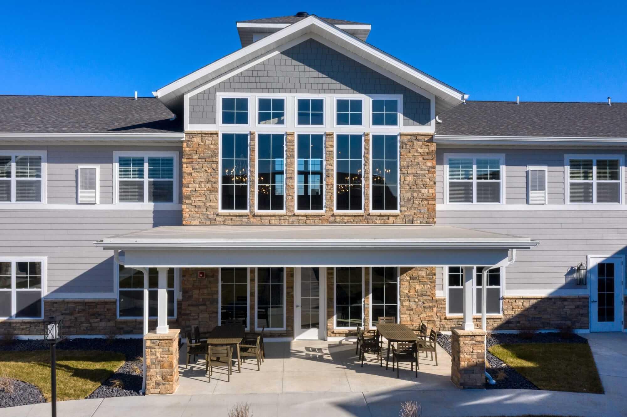 Exterior shot of Cedarhurst Arnold, showing custom masonry and windows