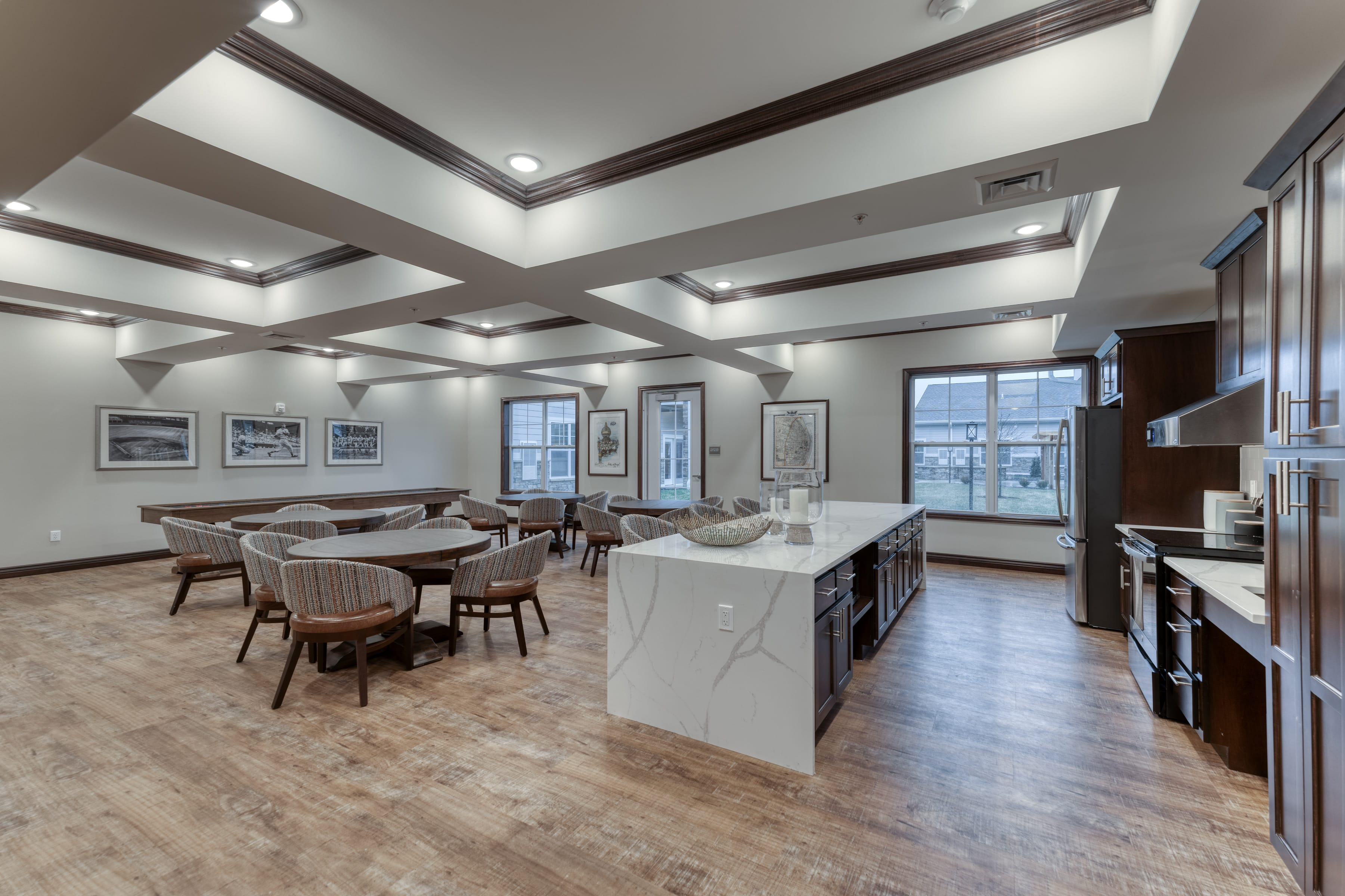 Round tables in this community room encourage residents to dine, socialize, or play games