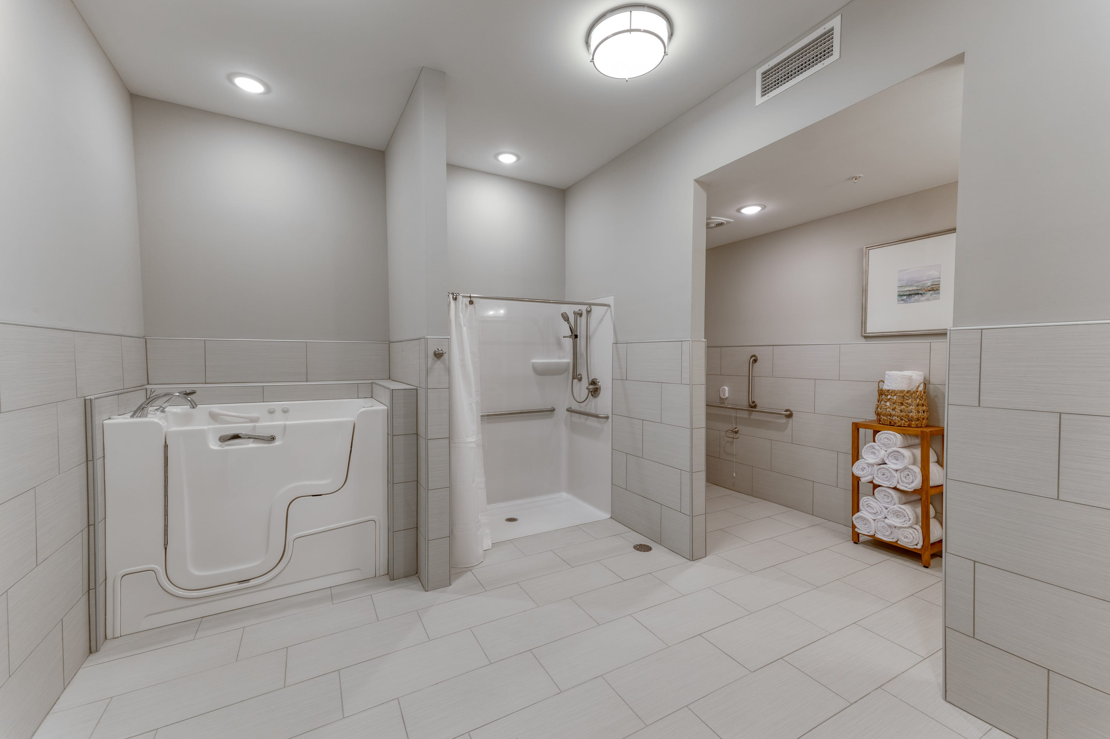 Accessible shower areas include sit-tubs and rail-equipped shower stalls