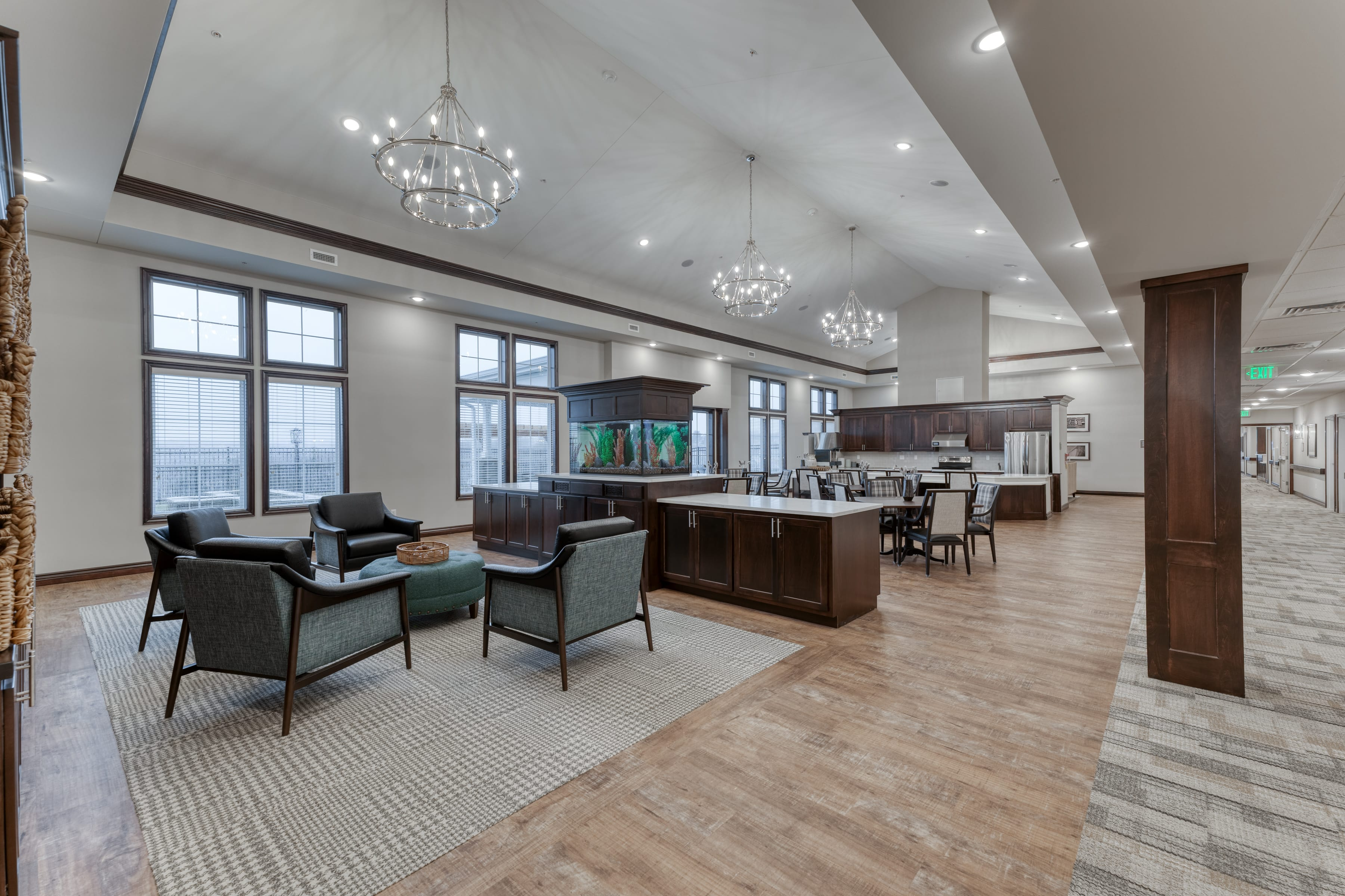 Open areas with tall ceilings and elegant lighting provide comfortable spaces for residents