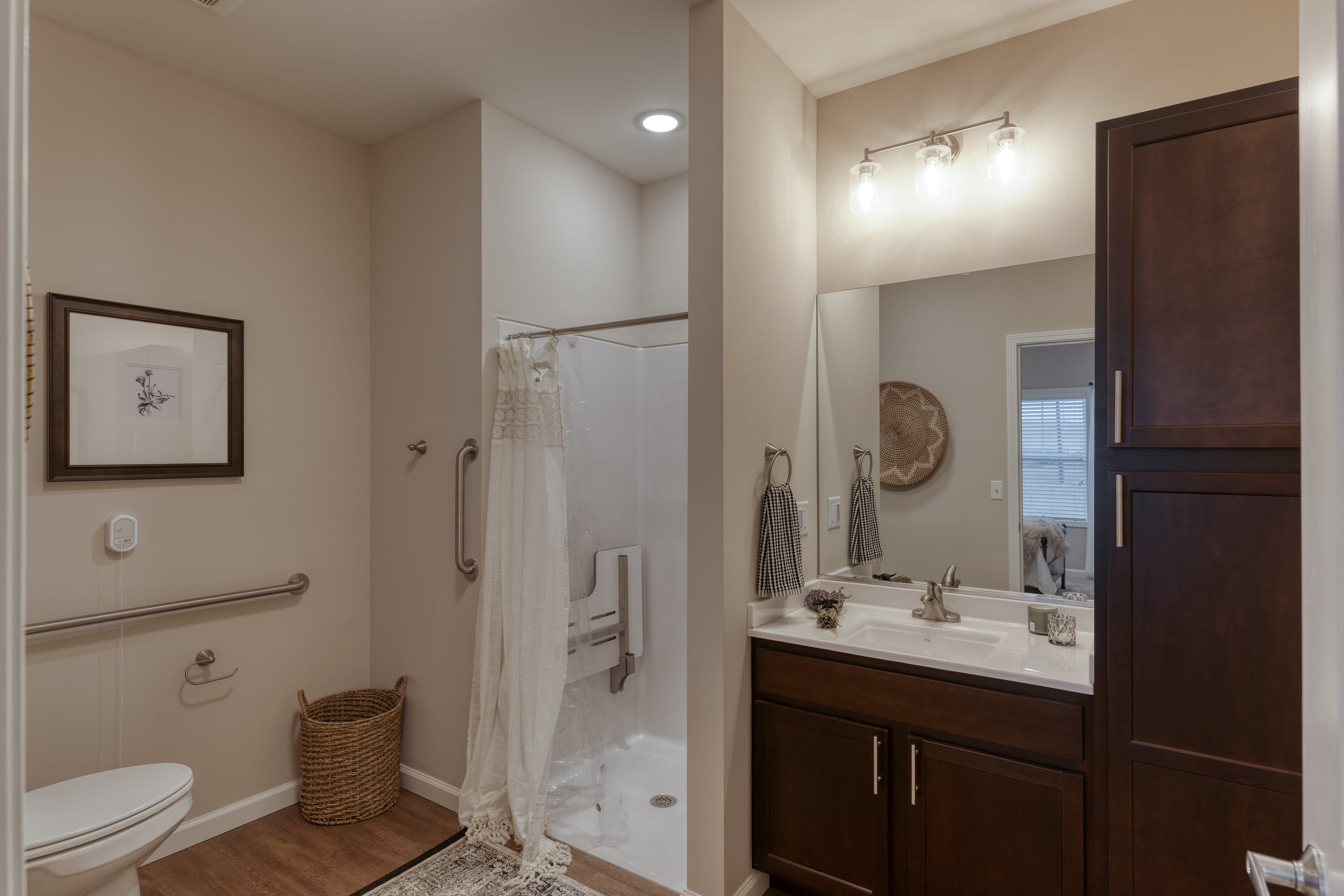 Private and accessible bathrooms include shower seats, railings, and other features