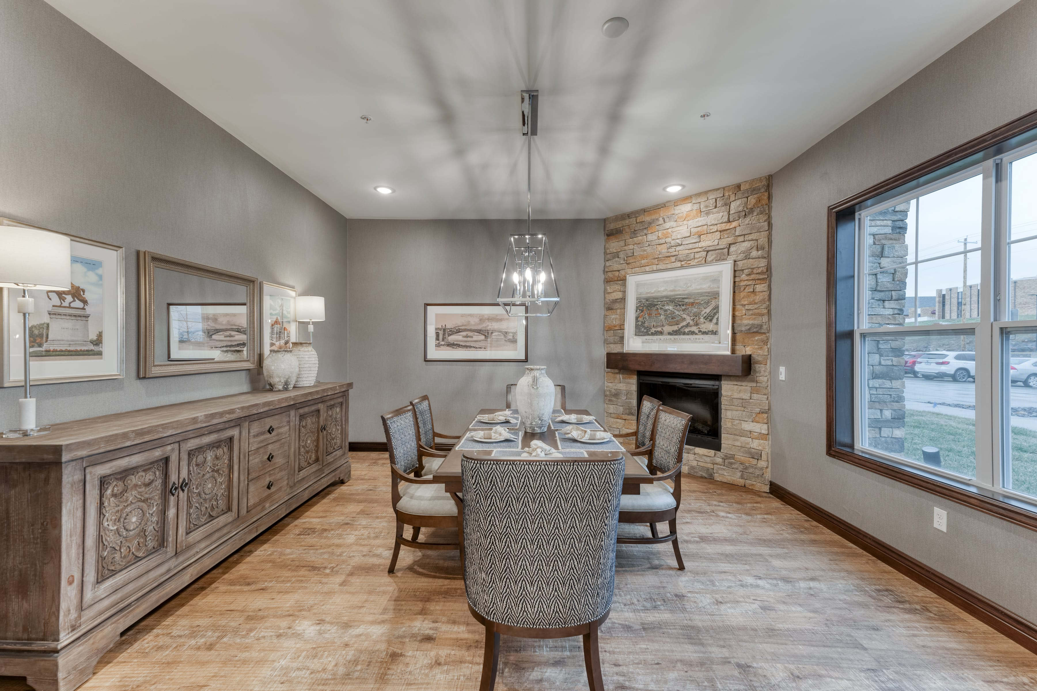 Unique lighting fixtures provide light and ambiance to this dining space