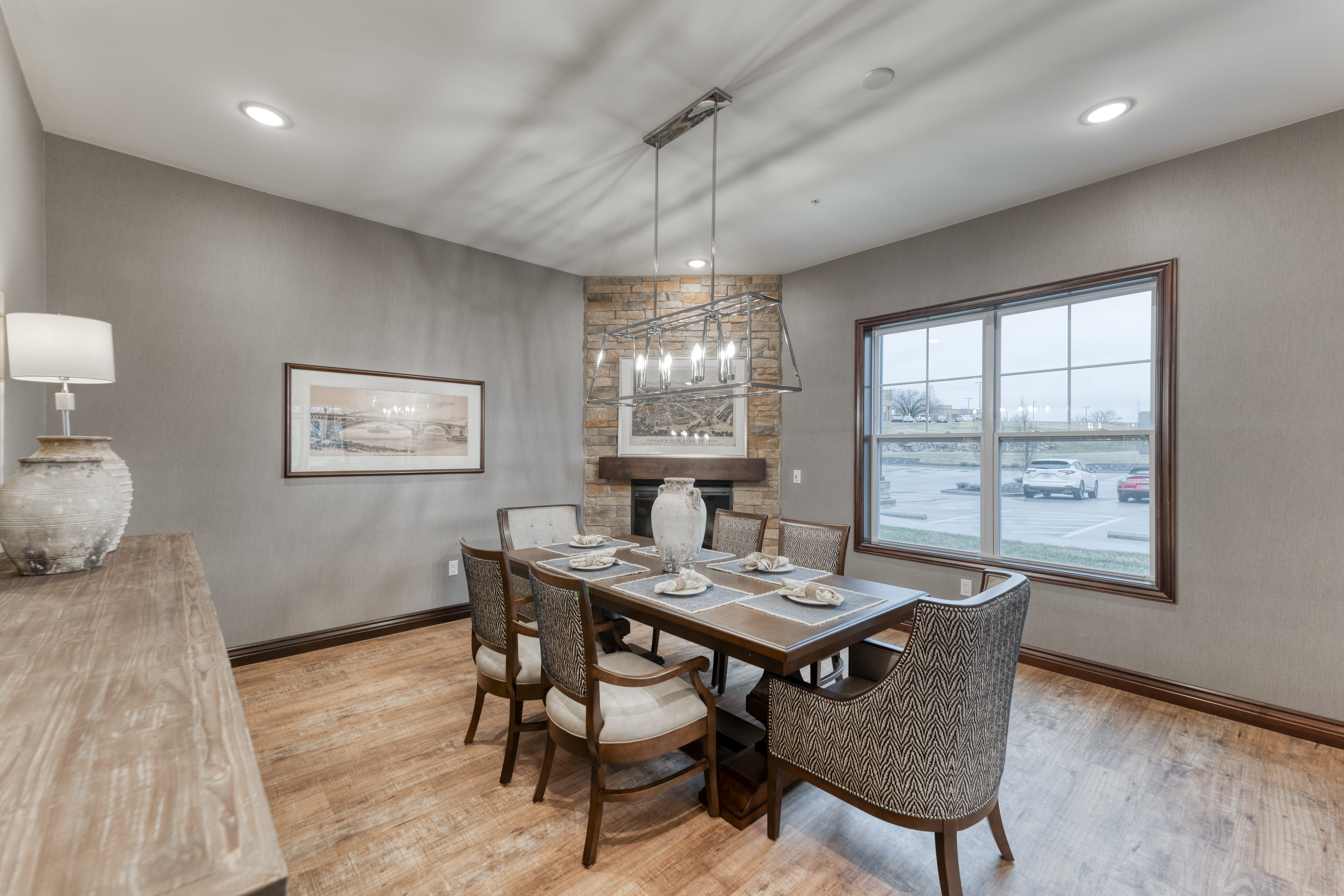 A stone fireplace adds ambiance and warmth to this dining space
