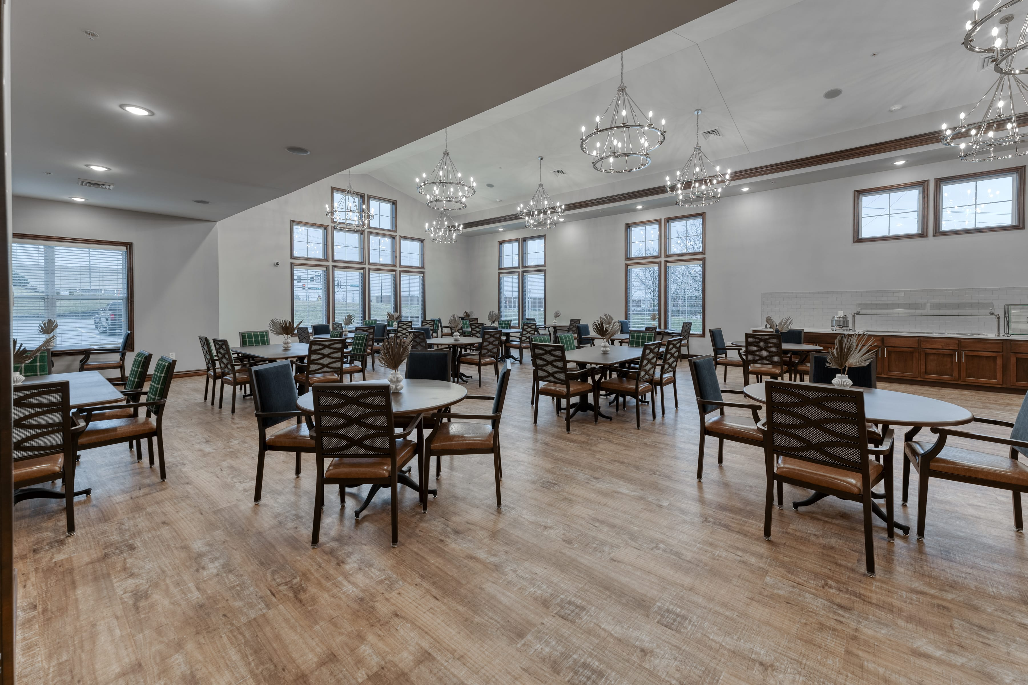 A large, open dining space welcomes residents at meal times and allows for flexible seating arrangements
