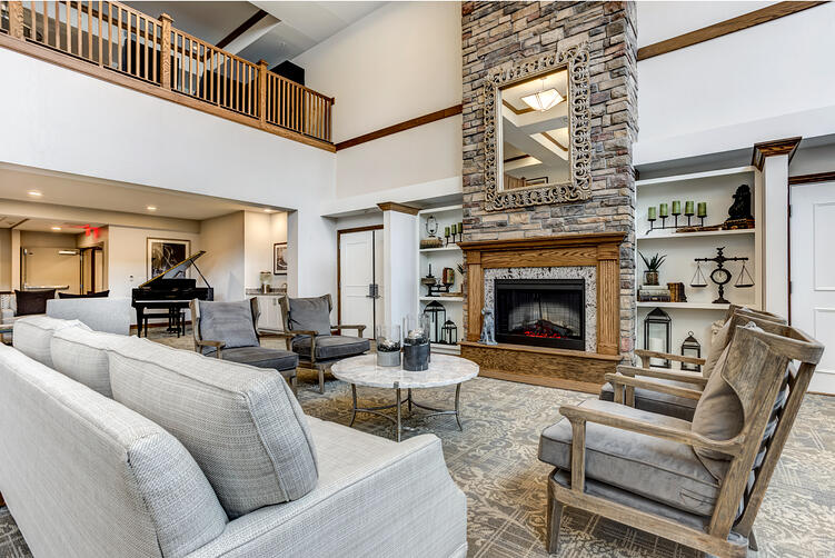 Custom Living Room with stone fireplace and contemporary furniture