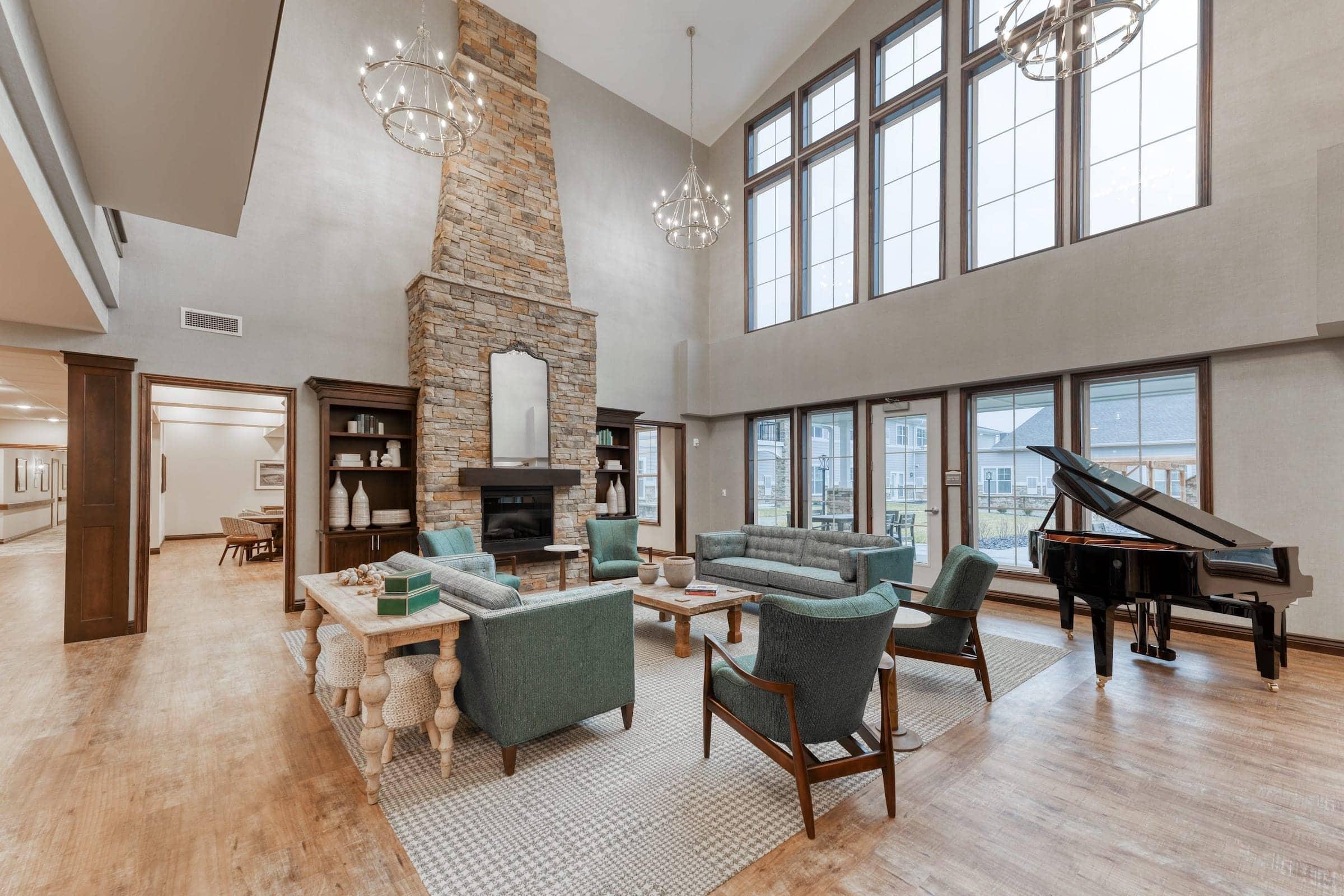 Cedarhurst Arnold open lobby with custom stone fireplace